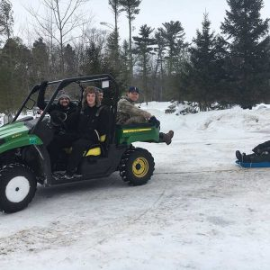 Having fun with a John Deere Gator in the Winter